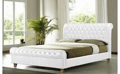 Stag Stores NEW 5ft FAUX LEATHER WHITE CHESTERFIELD SLEIGH BED FRAME Make a real statement with our dramatic Chesterfield style bed frame. The stunning Chesterfield bed comes in both a sumptuous dark brown and a beautiful white faux leather material and features deep-s http://www.comparestoreprices.co.uk/chesterfield-sofas/stag-stores-new-5ft-faux-leather-white-chesterfield-sleigh-bed-frame.asp