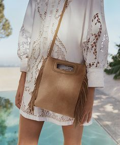 Maje introduces its new Spring Summer 2016 campaign starring the M bag. Discover more on www.maje.com #MdeMaje #SummerInMaje
