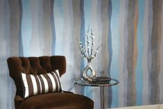 A blue and grey wavy striped wall