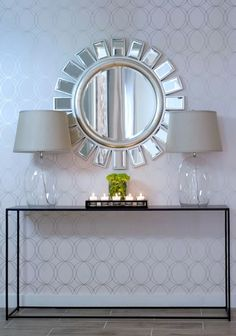 This is a clean and modern entryway with a gate pattern wallpaper, glass console table, sunburst mirror and glass lamps. Modern Entryway, Entryway Decor, Entryway Tables, Entryway Furniture, Cheap Furniture, Luxury Furniture, Wall Decor, Silver Sunburst Mirror, Home Interior