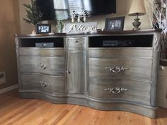 Painted French linen with a Graphite wash, dry brush with Coco and Paris gray. Clear and dark waxed and German silver gilding on all the edges to highlight. Top stained in Kona.