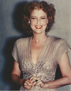My new acquisition: 8 x 10 color photo from an original negative of Jeanette MacDonald. This photo clearly shows she is not wearing a wedding ring on her left finger but surprise, surprise...it's Nelson's emerald ring with diamonds! - ESCANO COLLECTION