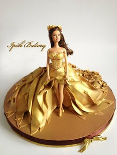"""Autumn Gold""Doll Cake - Air-brushed with edible gold colour with 24 carat edible gold Seasons Doll Cake Series! Barbie Torte, Bolo Barbie, Barbie Doll, Fondant Cakes, Cupcake Cakes, Doll Birthday Cake, Cake Design Inspiration, Wedding Dress Cake, Cake Decorating Tutorials"