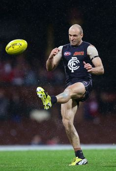 Chris Judd of the Blues kicks during the round 14 AFL match between the Sydney Swans and the Carlton Blues  at SCG on June 28, 2013 in Sydney, Australia.