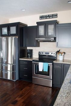 A kitchen tour with contrasting finishes such as dark cabinets, dark wood floors, and metal accents. Clean lines found in the hardware, cabinet faces, and backsplash. #darkcabinets #blackcabinets #kitchen