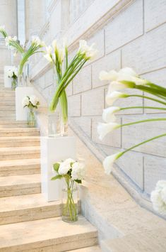 white calla lilies and white hydrangeas are gorgeous on these stairs! #wedding