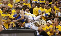 Golden State Warriors' Stephen Curry flies into the crowd in the first quarter during Game 2 of the NBA Western Conference Finals at Oracle Arena on Wednesday, May 18, 2016 in Oakland, Calif. Photo: Scott Strazzante, The Chronicle