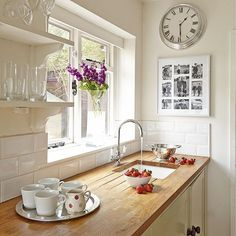 Neutral kitchen with clock | Kitchen designs | bespoke kitchens | Beautiful Kitchens | Housetohome
