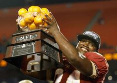 Florida State Seminoles fullback Lonnie Pryor holds his most valuable player trophy after they defeated the Northern Illinois Huskies in their 2013 Discover Orange Bowl NCAA football game in Miami, Florida January 1, 2013.