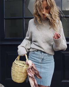 Slouchy sweater with denim skirt and basket bag