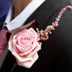 Edward and his groomsmen wore boutonnieres made of pink roses made by florist, Sally Richardson. Image Credit: Charlene Morton