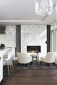 Are you considering making your kitchen cozier? A fireplace adds to the comfort level in any room. Keep reading as we share seven reasons why you should consider a fireplace in your kitchen makeover! Hadley Court Interior Design Blog by Central Texas Interior Designer, Leslie Hendrix Wood. Decor, Kitchen Marble, Marble Fireplaces, Contemporary Living Room, Contemporary Fireplace, Fireplace Design, Home Decor, White Modern Kitchen, Modern Fireplace
