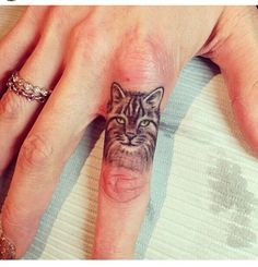Small but detailed finger tattoo - extra points for it being of a cat :) Love my little boy so much would definitely consider getting his face tattooed M.L