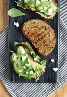 Veggie Sandwich with Hummus, Arugula, Grilled Eggplant, Avocado, Basil and Goat Cheese Crumbles on Toasted Seeduction Bread