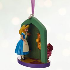 Take a journey down the rabbit hole with this stunning Alice In Wonderland decoration. Featuring the Cheshire Cat answering the door to Alice, it will make a magical addition to any festive tree.