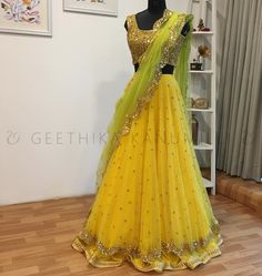 Stunning sun shine yellow color lehenga and sequence gold color crop top with parrot green color net duatta. Lehenga with buti design hand embroidery work all over.  07 April 2018