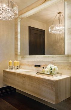 glamorous chandelier and travertine bathroom :: Luxuriously modern Colorado mountain home