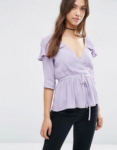 Pretty in a purple blouse.