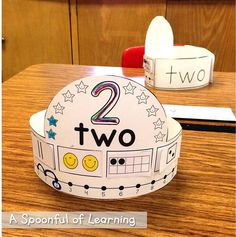 Number Hats: tally marks 2 smile faces ten frame die number line word colo Teaching Numbers, Numbers Kindergarten, Kindergarten Math Activities, Numbers Preschool, Math Numbers, Preschool Math, Math Classroom, Teaching Math, Math Workshop