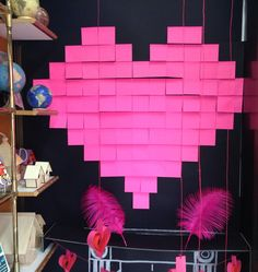 Post it heart window display. Could post it an 8 bit bright retro design for a gamer/graphic novel window.
