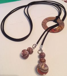 Lariat, made with polymer clay beads and hoop.