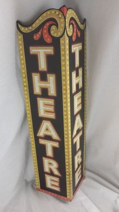Theater Triangle Embossed Metal Sign Emboss Triangles and Lobbies