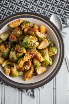 Quick and easy oven roasted brussels sprouts that are finished with a sweet and spicy glaze full of hoisin and chili garlic sauce.