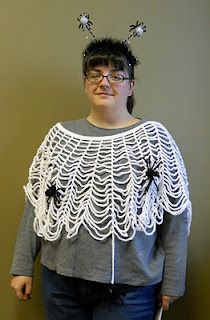 Crochet a spider web poncho for Halloween.