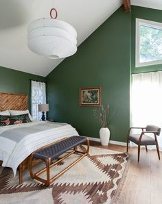 camp-y chic bedroom with green walls