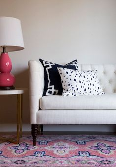 Kismet rug in coral // Caitlin Wilson. Rug and pillow combo, love.