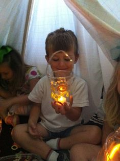 DIY preschool camping lanterns made with Solo cups and Dollar Store faux candles!