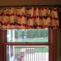 Dish towels from Target (bold cherries)made into a valance for my kitchen window. I folded the curtains in half, used fabric glue to keep both sides together, added some green rickrack to the bottom with glue and used curtain clips to hold them up. Quick, easy and cute!
