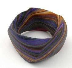 'Violet bark' bracelet 2009 by Susanne Holzinger Glued layered paper block, carved.