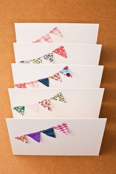 mini-bunting cards http://whipup.net/2010/01/27/mini-fabric-bunting/