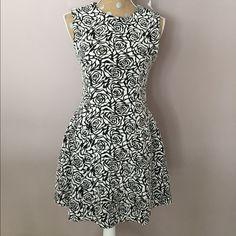 """Forever 21 Roses Dress Black and white rose pattern. Like new condition. 32"""" length, 16 1/2"""" across bust. Forever 21 Dresses Midi"""