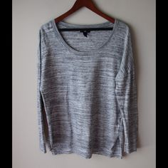 """GAP grey melange top Grey melange lightweight top - long sleeves - rounded neck - slits at front - 100% cotton - loose fitting body with more fitted sleeves - dropped shoulder style - chest across measures 22"""" - total length measures 27"""" - size L GAP Tops"""