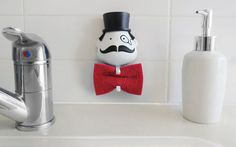 Mr. Sponge Sponge Holder  After a long day of cleaning and scrubbing, your hard-working sponge gets his moment to chill and dry out as Mr...