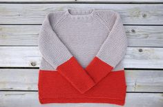 "This beautifully easy, seamless raglan is a cozy layering piece.  Slightly oversized fit, knit in garter stitch with split side seam and colorblocking detail.  Knit in soft cotton blend, but would be perfect in a soft wool for winter.  To fit -one size- US Women's Size 6-8:Bust 34"" - 36""::Finished Bust: 38""Waist 27"" - 28""  ::Finished Waist 40""Hip 38"" - 40""::Finished Hip: 43""This is a simple knit with easy construction.  Circular knitting, knit, purl, decr..."