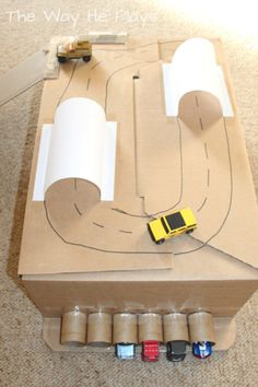 DIY cardboard box toy car race track play for toddlers and kids. Simple toy car and box play Cardboard Car, Cardboard Box Crafts, Cardboard Race Track, Cardboard Playhouse, Cardboard Furniture, Projects For Kids, Diy For Kids, Crafts For Kids, Carton Diy