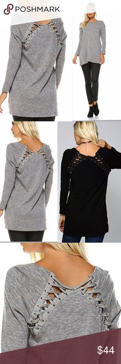 "GRAY TIE SWEATER Soft black closely knitted black tunic sweater with lace up detailing on the back. Semi-fitted. If in doubt about size, order up. A medium measures 19"" pit to pit and 33"". 97% acrylic. 3% spandex. ALSO AVAILABLE IN BLACK. Sweaters Crew & Scoop Necks"