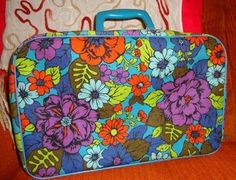 1960s Flower Power suitcase. Yes I had one off these. On mine the background color was brown