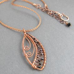 Copper Filigree Leaf Pendant with Black Crystal Accents