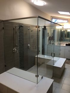 Custom Glass Shower Enclosure - Double 90 Degree Glass Shower Enclosure with Deluxe Header. Contact Arrow Glass and Mirror, located in Austin, TX today to learn more 512-339-4888 or email sales@glassgang.com.