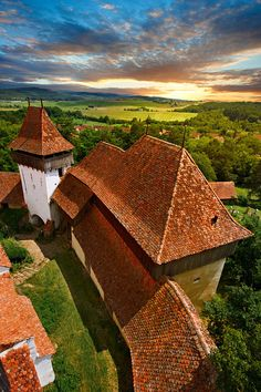 View of the church tower of the Szekly medieval fortified church of Viscri, Buneşti, Braşov, Transylvania. Started in the 1100's. UNESCO World Heritage Site