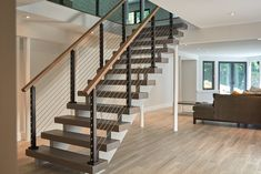 This urban home in New York achieves an open feel with several flights of floating stairs accompanied by cable railing with Aluminum posts.