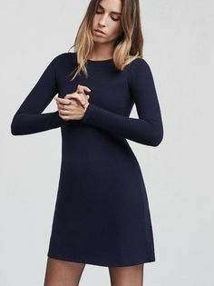 The Sabina Dress in Navy is a long sleeve mini dress made from ribbed stretch jersey. It's slightly A-line and basically the thing to throw on when you want to feel like a leggy babe rolling around France in the 1960s. Word.  - https://www.thereformation.com/products/sabina-dress-navy?utm_source=pinterest&utm_medium=organic&utm_campaign=PinterestOwnedPins