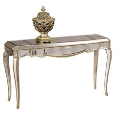 Mirrored console table with antiqued golden trim and a French Regency-style silhouette.    Product: Console table  Con...