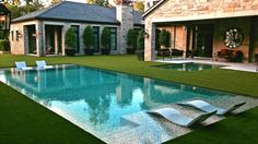 This pool Incorporates a grass-edge look created by Bobe Water & Fire. It was built by Paragon Pools.