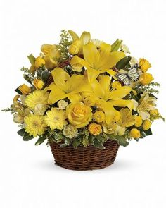 A natural brown basket is packed with yellow lilies, gerberas, roses, button spray chrysanthemums, carnations and delicate green leaves. $52.95