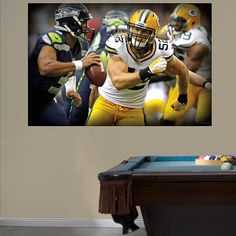 DIY Wall Murals | NFL Sports | A Fathead stays up on its own with a low-tac adhesive that won't damage your walls, making this wall graphic easy to move and reuse. SHOP http://www.fathead.com/nfl/green-bay-packers/clay-matthews-pursuit-mural-wall-decal/ | DIY Bedroom Decor for Boys + Girls | Custom Decals | Peel & Stick | Man Cave